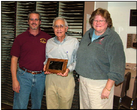 Les Susi (center) receiving the Founder's Award - Former Director Tim Jameson (left) and Lisa Galvin (former Band Chair) on right